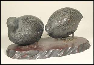 Pair of Japanese bronze game birds on a wood base.