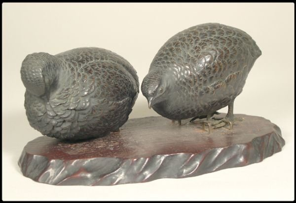 11: Pair of Japanese bronze game birds on a wood base.