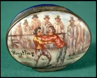 Battersea enameled snuff box with wrestling scene.