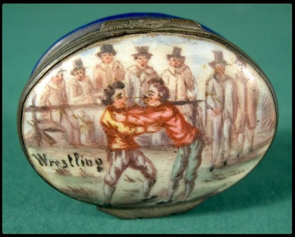 24: Battersea enameled snuff box with wrestling scene.