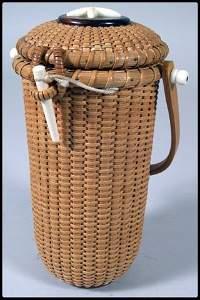 521: Nantucket tall narrow circular purse. Rosewood ins