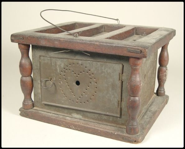 656: 19th Century foot stove with heart shaped pierced-