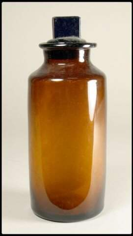 Brown glass apothecary bottle with stopper. Heigh