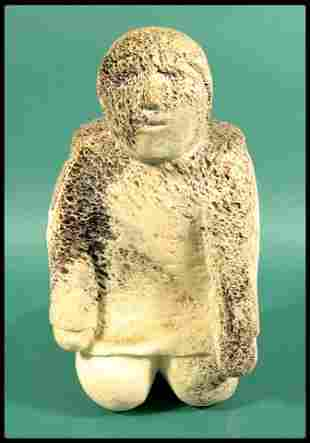 """An Inuit carving of a kneeling figure, 12 3/4""""H."""