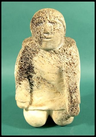 """666: An Inuit carving of a kneeling figure, 12 3/4""""H."""