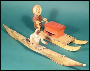 An Inuit carved and painted kayak with an Eskimo a