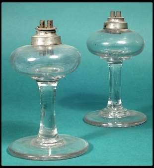 Pair of early blown glass and pewter oil lamps, pe