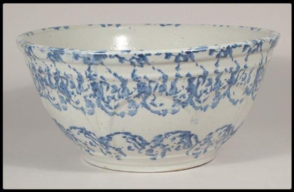"672: Blue and white spongeware bowl, 12""D."