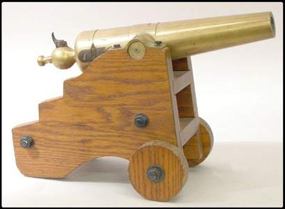 985: A bronze cannon, ca. 19th century on an oak stand,