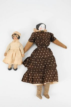 Victorian China Head Doll & 1920's Oil Cloth Doll