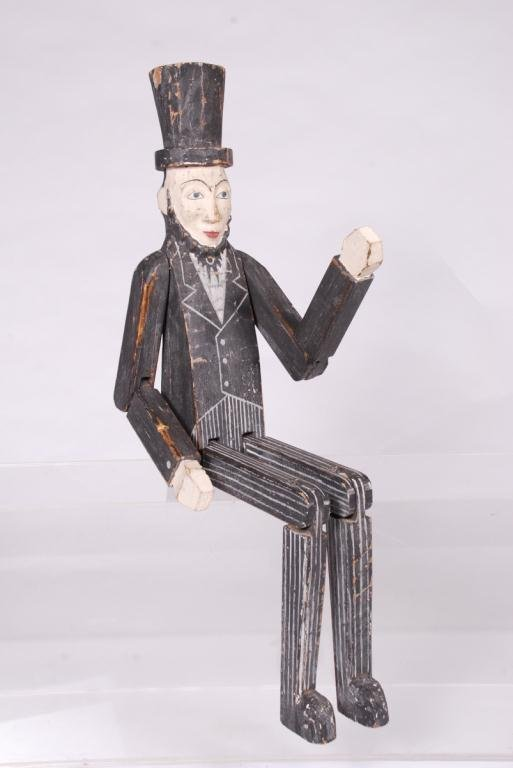 CARVED AND PAINTED ARTICULATED ABE LINCOLN FIGURE