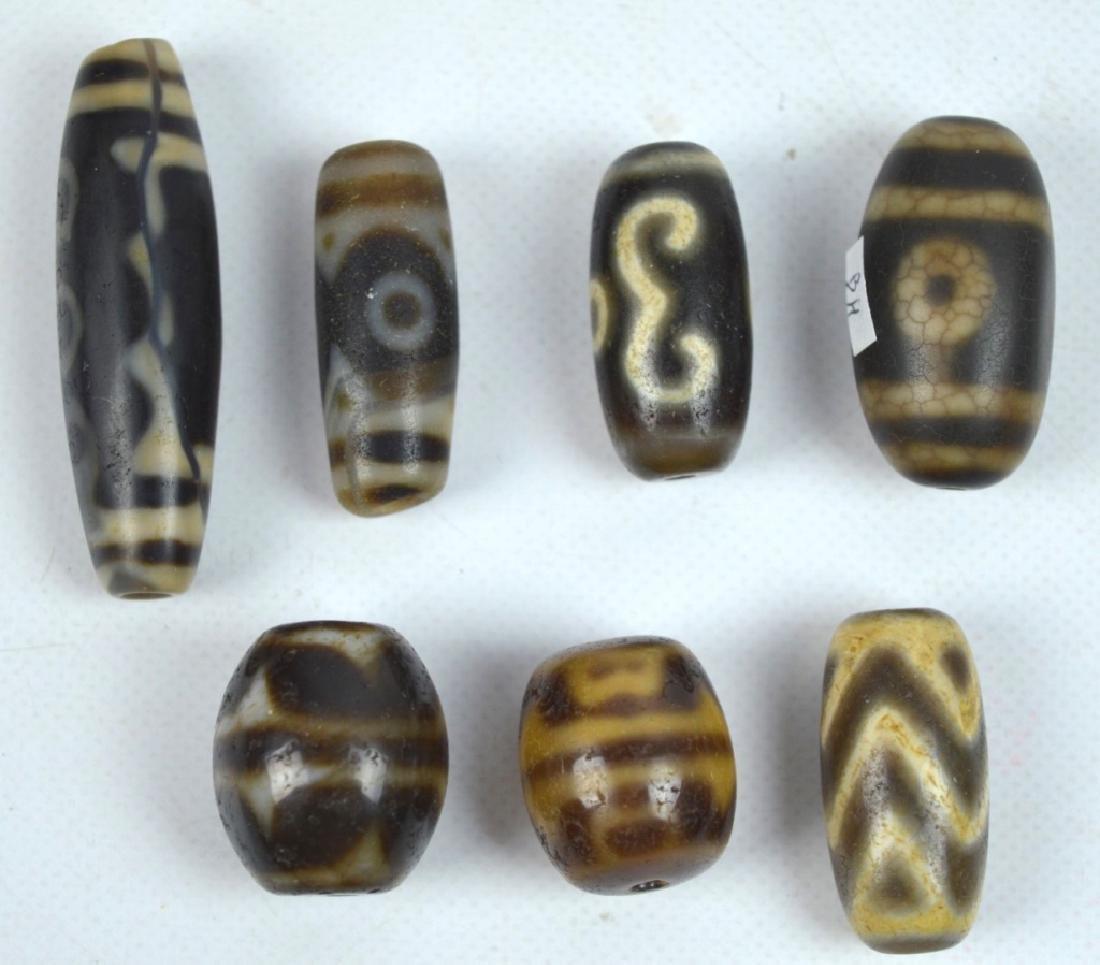 7 Antique Tibetan Dzi Beads