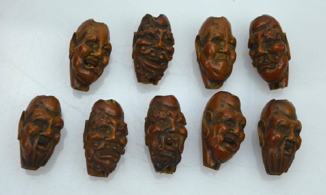 9 - Carved Chinese Peach-Pit Lohan-Head Beads