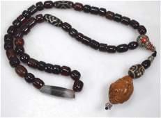 Chinese Hotai Pendant, Cherry Amber & Dzi Beads