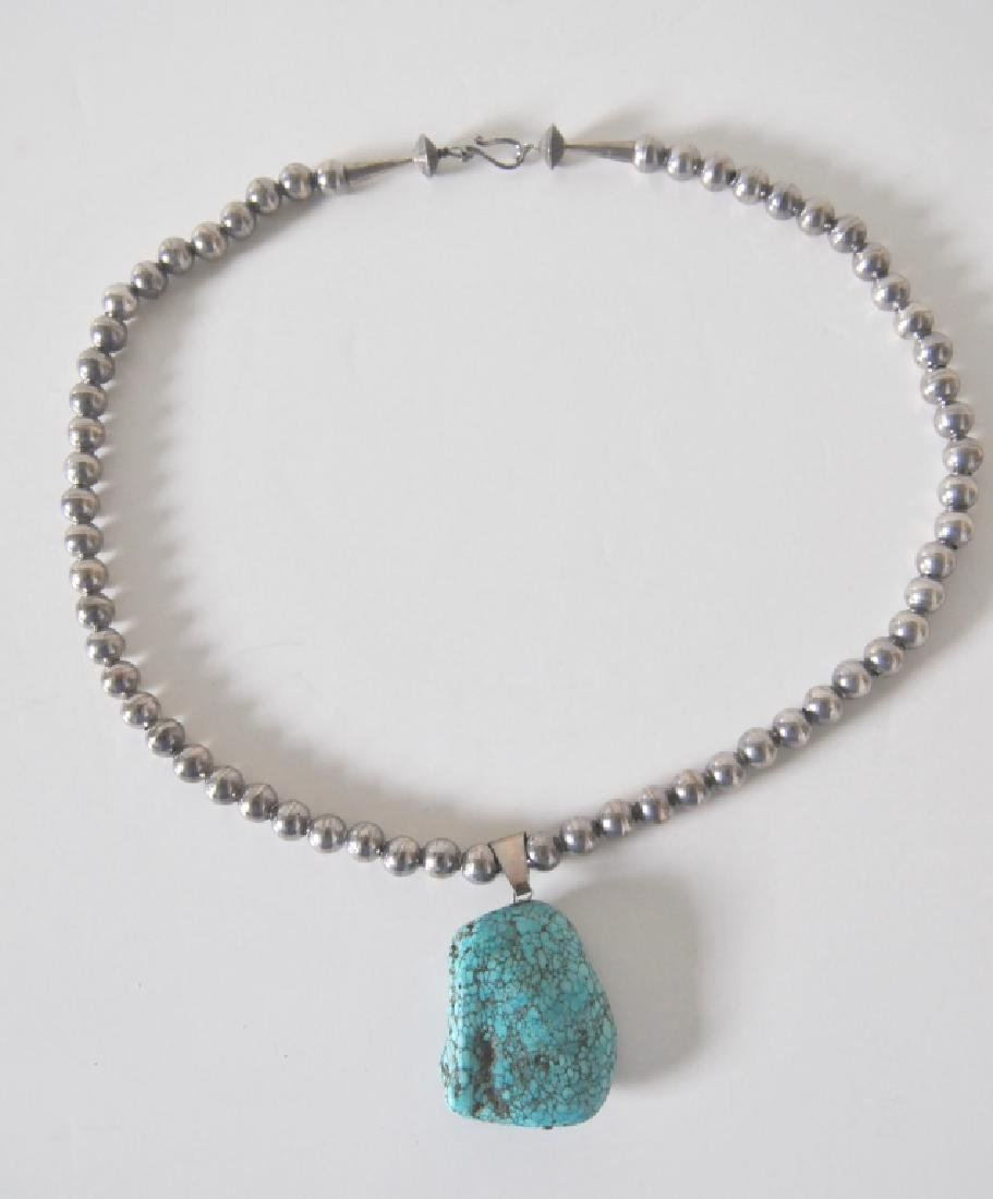 Spiderweb Turquoise Nugget on a Silver Bead Necklace