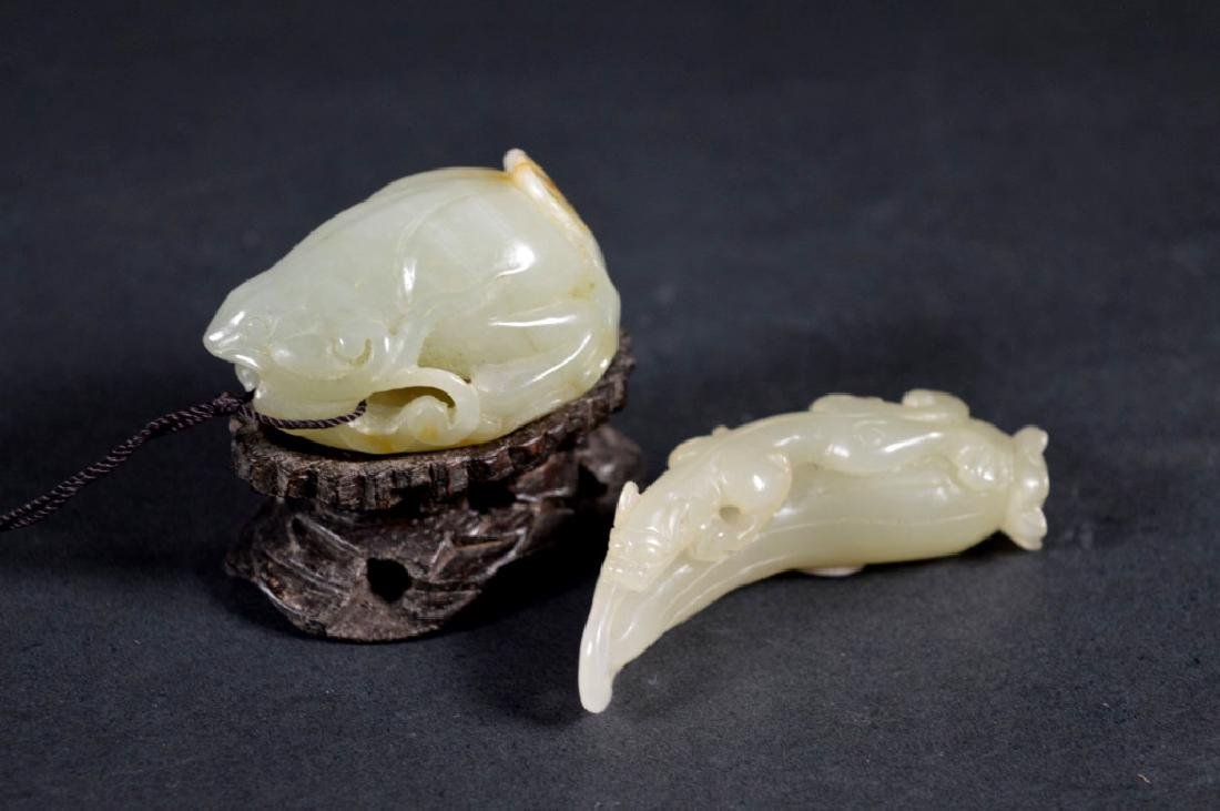 Two Chinese Carved Jade Pebbles; Wood Stand