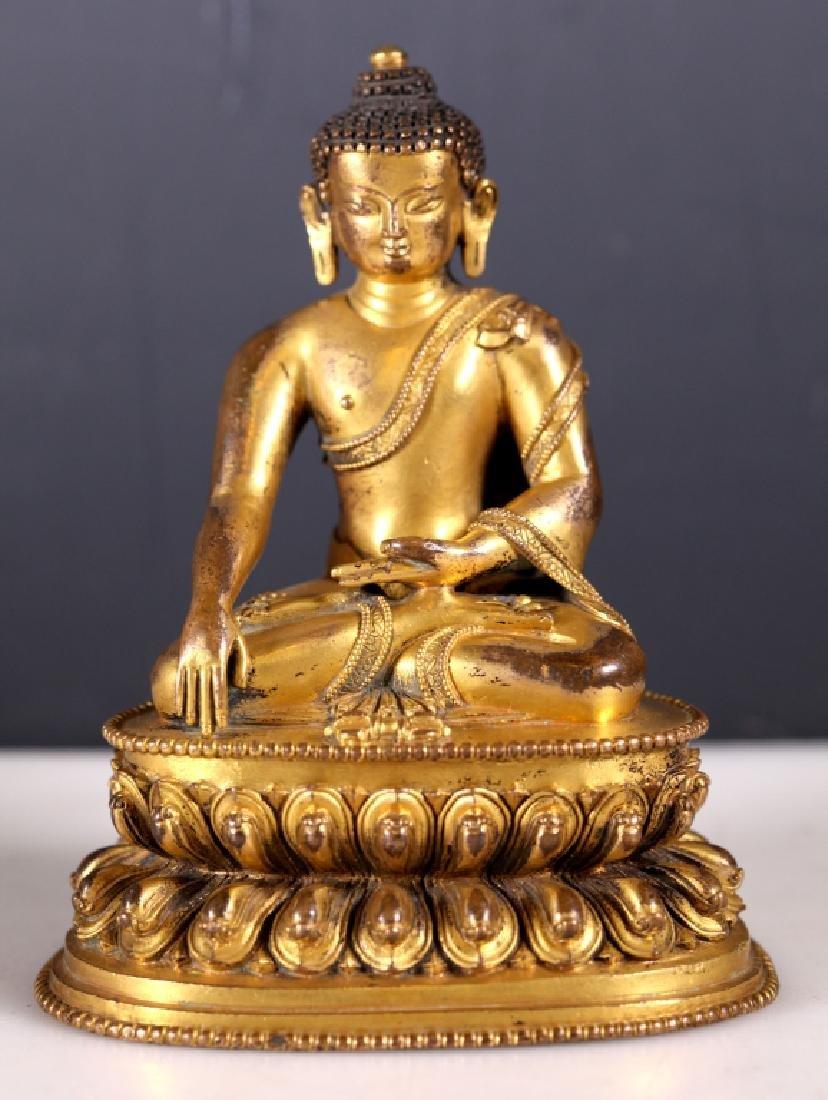 Tibetan 17C Gilt Bronze Seated Buddha on Throne