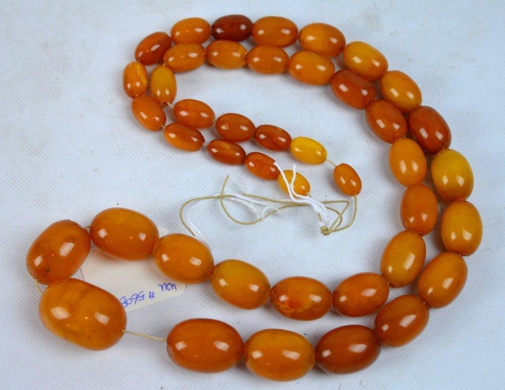 Antique Butterscotch Amber Beads, weight 91G.