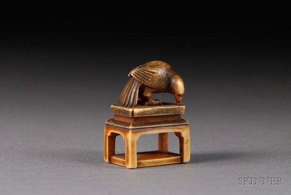 302: Ivory Netsuke, 19th century, a parrot on a stand,