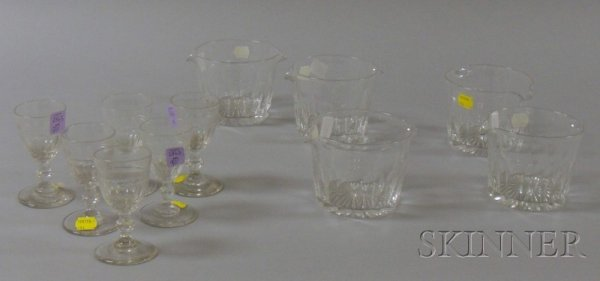 9: Eleven Colorless Glass Wine Serving Pieces, five win