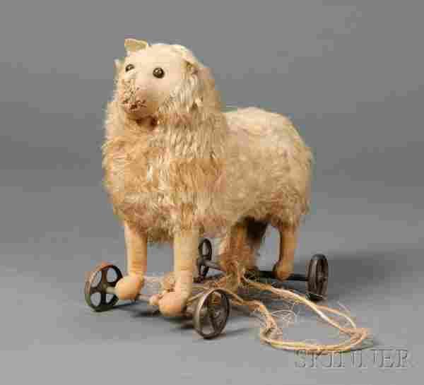 715: Early Steiff Blonde Mohair Dog on Wheels, c. 1913,