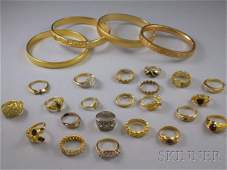 313: Small Group of Costume Jewelry, including four gol