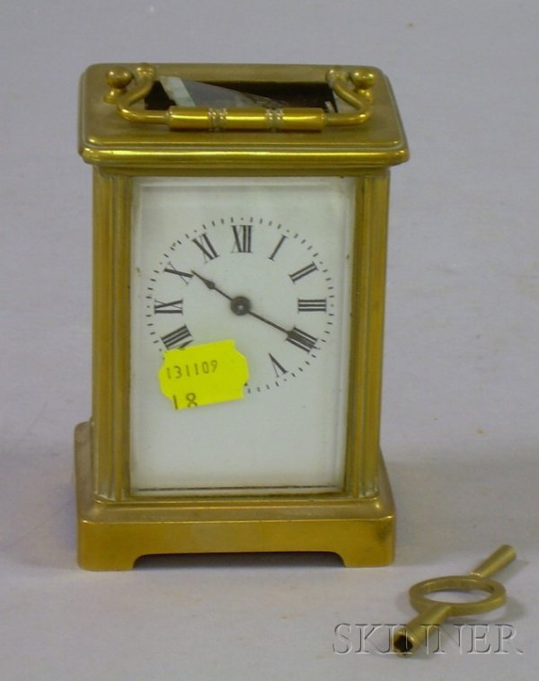 512: French Brass Carriage Clock, with enameled Roman n