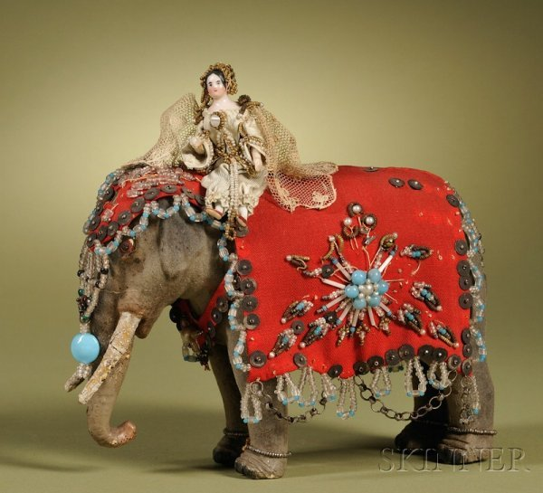 6: China Doll with Wood Body Riding an Elephant, German