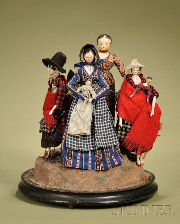 7: Early Wooden Dolls in an Early Victorian Domed Vigne