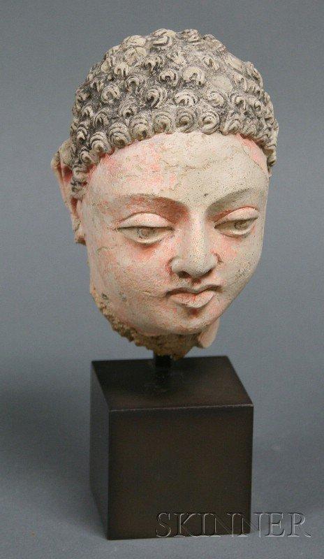 5: Stucco Head of Buddha, Gandhara, 2nd century B.C., t
