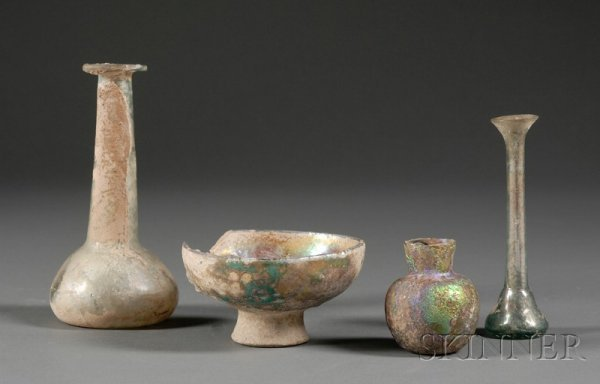 12: Four Antiquities, three pieces of Roman glass and a