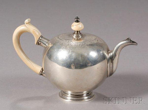 19: Dutch Silver Teapot, c. 1740, globular body with ap