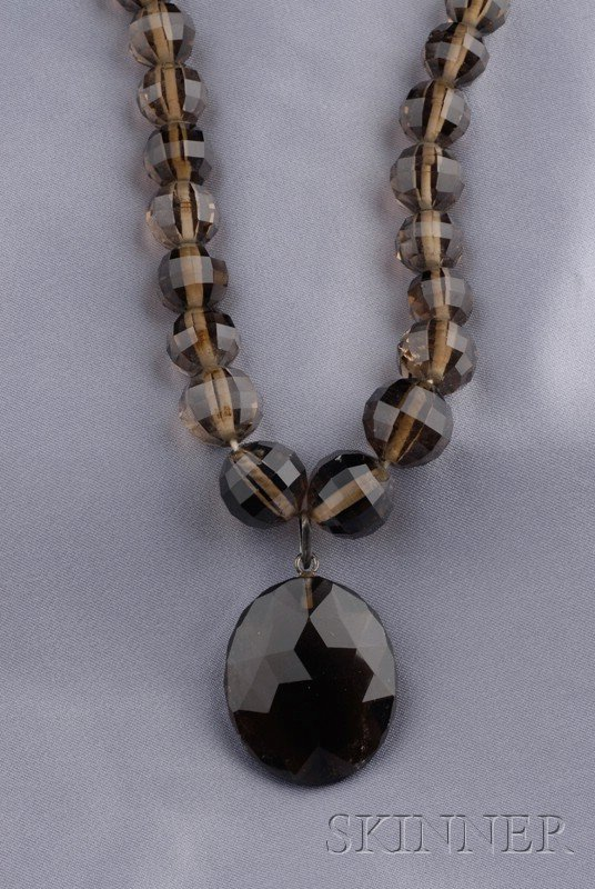 12: Smoky Quartz Pendant Necklace, composed of graduati