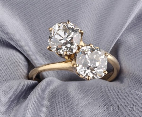 489: Twin-stone Diamond Bypass Ring, prong-set with two