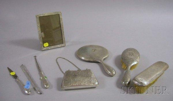 3: R. Wallace Eight-Piece Sterling Silver Dresser Set.