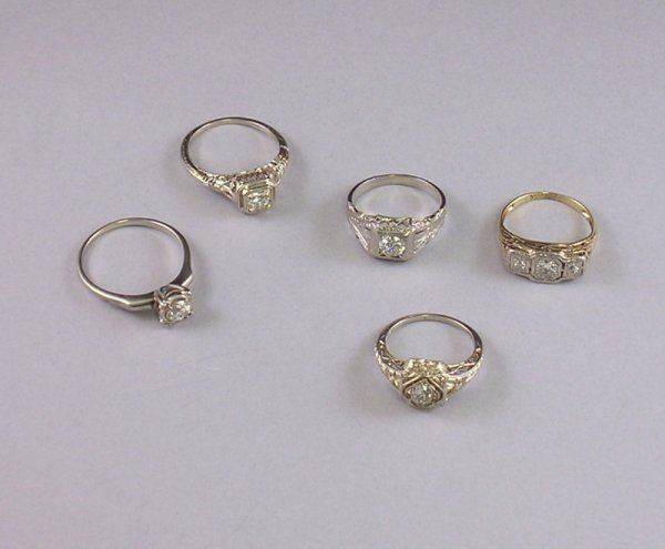 284: Five Gold and Diamond Rings, two in 18kt white gol