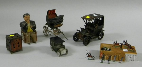 810B: Group of Painted Metal Banks and Toys, a painted