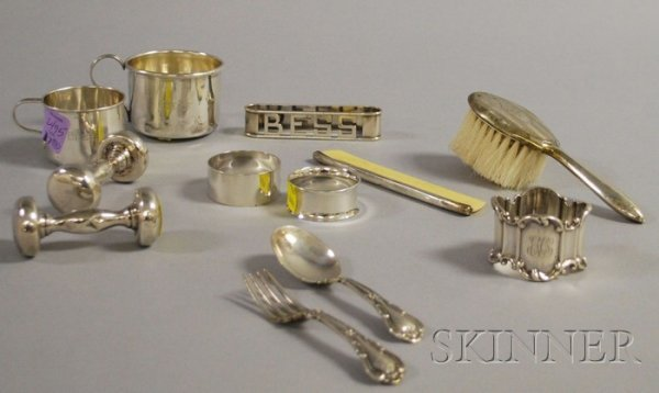 17: Approximately Twelve Child's Sterling Silver Tablew