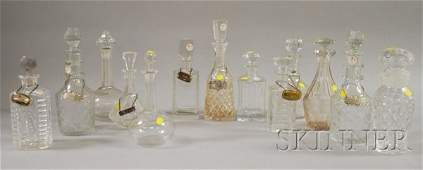 1084: Thirteen Colorless Cut and Pressed Glass Decanter