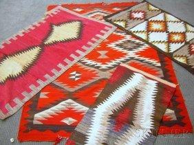 4: Four Navajo Rugs, geometric patterns, (some damage),