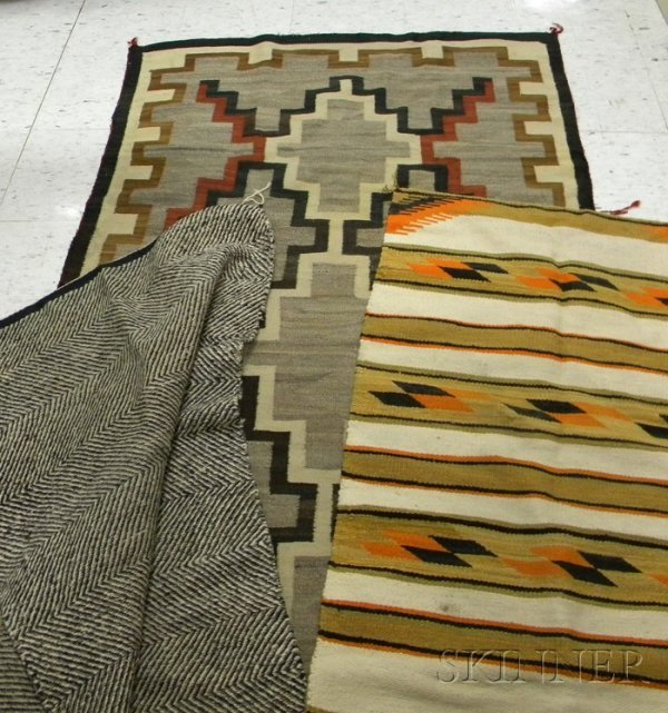 6: Three Navajo Rugs, one tan, orange, black, and white