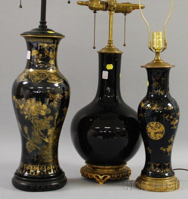 895: Two Chinese Gilt Decorated Black Glazed Ceramic Ba