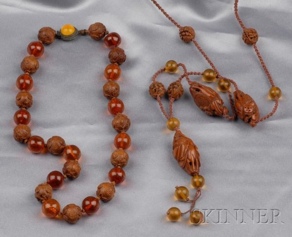 13: Two Carved Peach Pit and Amber Bead Necklaces, one
