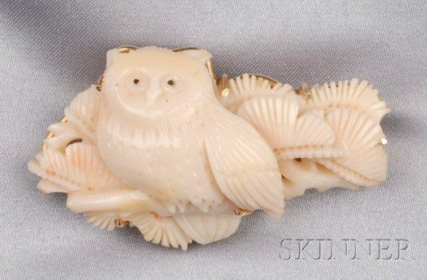 22: Coral Brooch, carved to depict an owl perched among