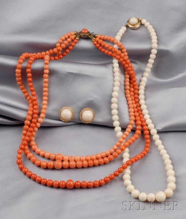 23: Group of Coral Jewelry Items, a triple strand neckl