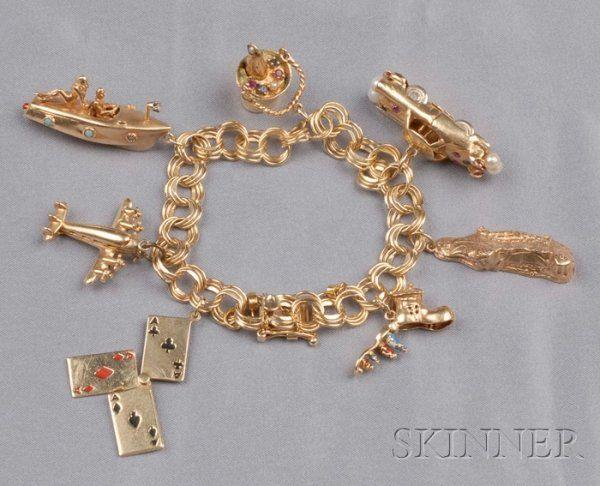 265: 14k Gold Charm Bracelet, four aces, an airplane, i