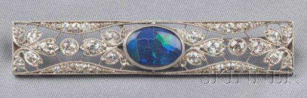 706: Art Deco Platinum, Black Opal, and Diamond Brooch,
