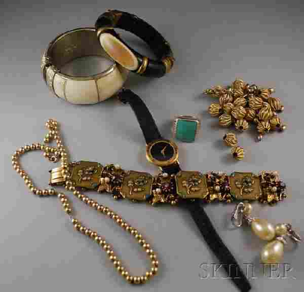 343: Small Group of Jewelry, including two bangle brace