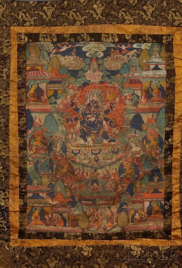 721: Thangka, Tibet, color and gilt on cloth, brocade b
