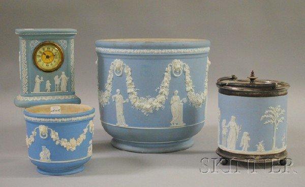 517: Four Wedgwood Light Blue Jasper Dip Items, a silve